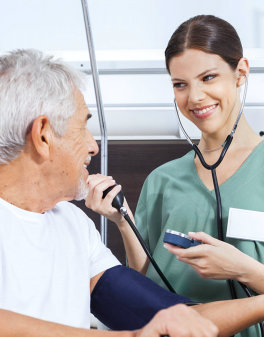 woman checking the blood pressure of senior